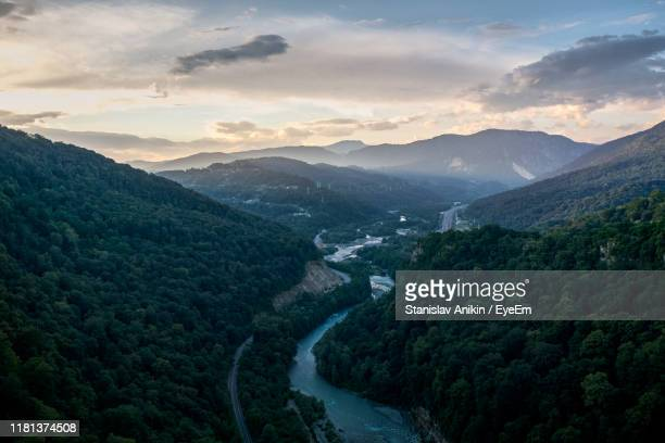 high angle view of river amidst mountains against sky - sochi stock pictures, royalty-free photos & images