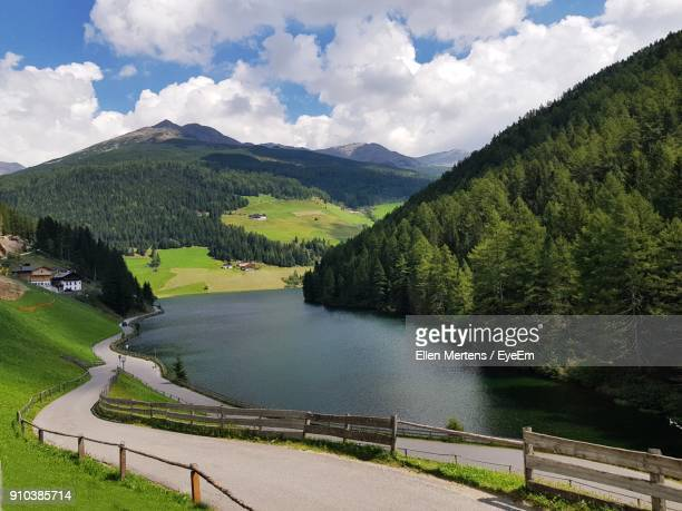 high angle view of river amidst mountains against sky - mertens stock pictures, royalty-free photos & images