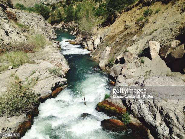 High Angle View Of River Amidst Rocks