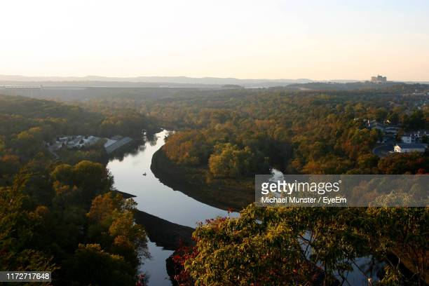 high angle view of river amidst trees against sky - branson missouri stock pictures, royalty-free photos & images