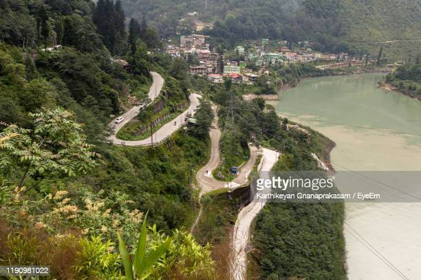 high angle view of river amidst trees - sikkim stock pictures, royalty-free photos & images