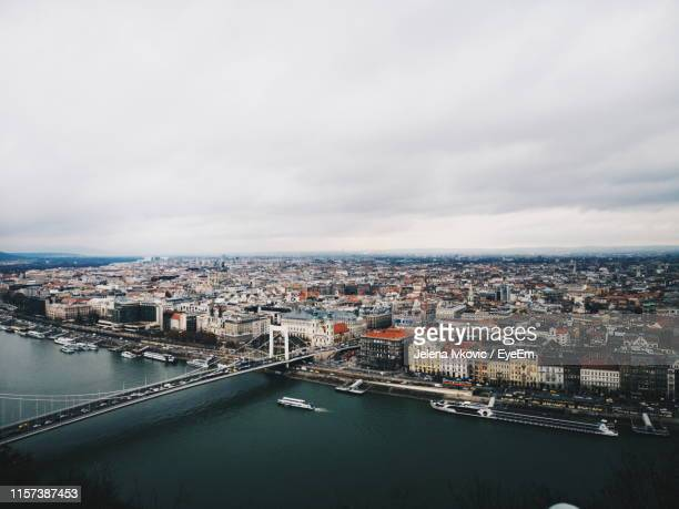 high angle view of river and cityscape - jelena ivkovic stock pictures, royalty-free photos & images