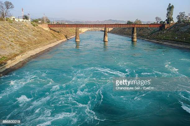 high angle view of river below bridge - punjab - india stock pictures, royalty-free photos & images
