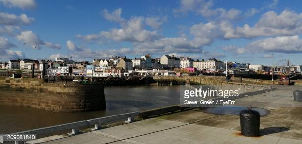 high angle view of river by buildings against sky - bridlington stock pictures, royalty-free photos & images