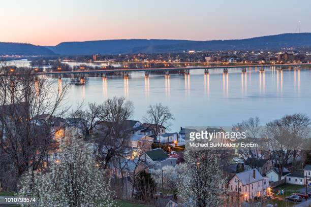 high angle view of river by buildings in city at sunset - pennsylvania stock pictures, royalty-free photos & images