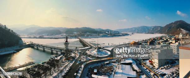 high angle view of river by city against sky during winter - gangwon province stock pictures, royalty-free photos & images