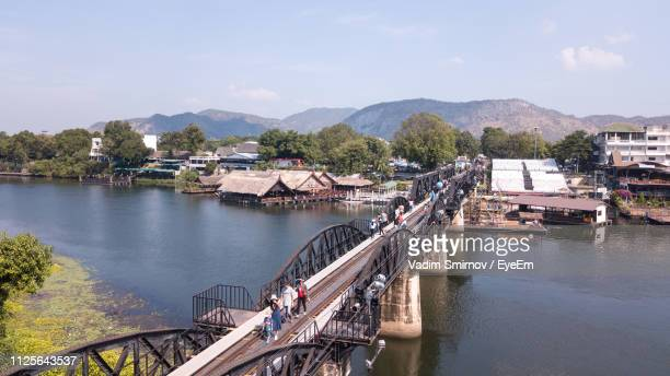 high angle view of river by city against sky - カンチャナブリ県 ストックフォトと画像