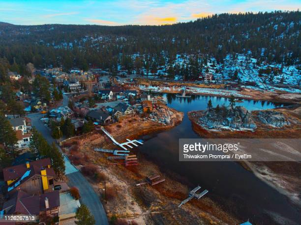 high angle view of river by city against sky - big bear lake stock photos and pictures