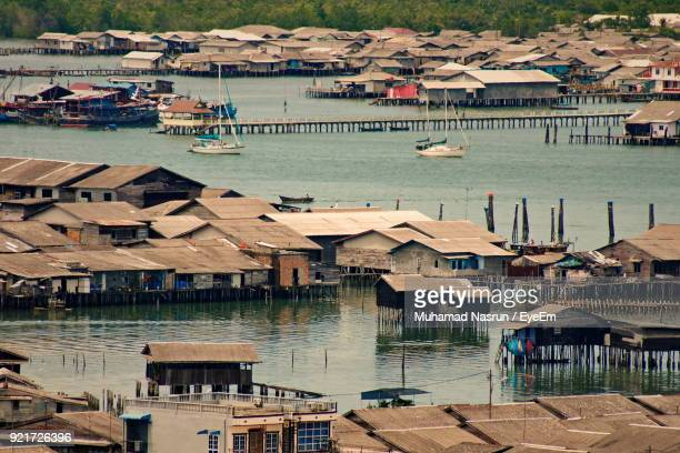 high angle view of river by city - muhamad nasrun stock pictures, royalty-free photos & images