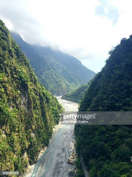 High Angle View Of River Flowing Through Mountains