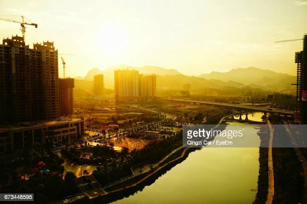 High Angle View Of River In City During Sunset