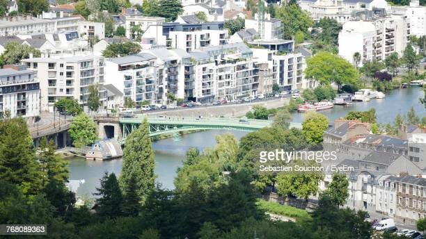 high angle view of river in city - nantes photos et images de collection