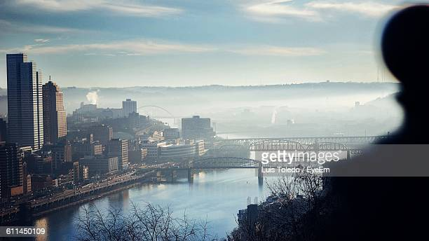 high angle view of river with buildings against the sky - pittsburgh bildbanksfoton och bilder