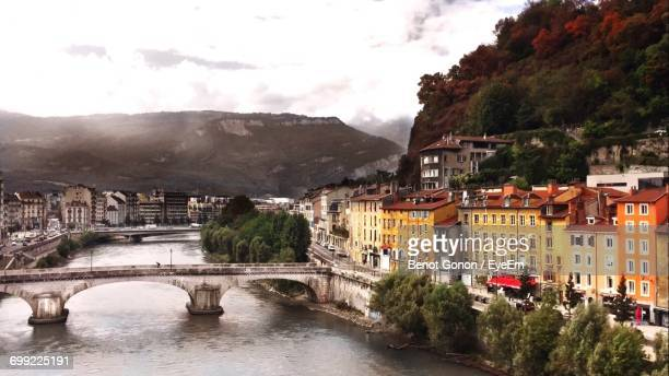 high angle view of river with cityscape in background - grenoble photos et images de collection