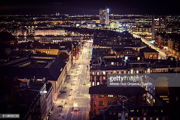 high angle view of road along illuminated buildings at night - copenhagen stock pictures, royalty-free photos & images