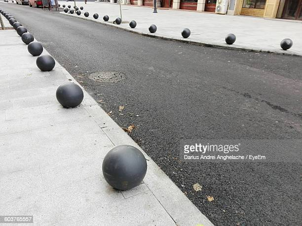 High Angle View Of Road Amidst Bollards