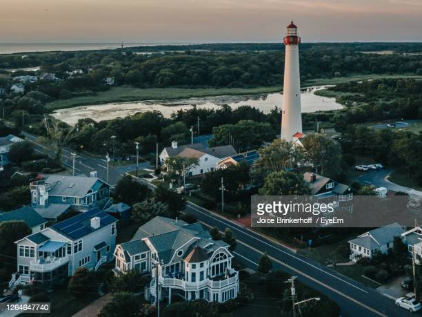 high angle view of road amidst buildings in city. cape may new jersey lighthouse from above - cape may stock pictures, royalty-free photos & images