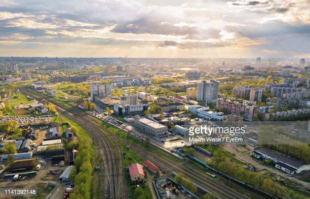 high angle view of road amidst buildings in city - minsk stock pictures, royalty-free photos & images