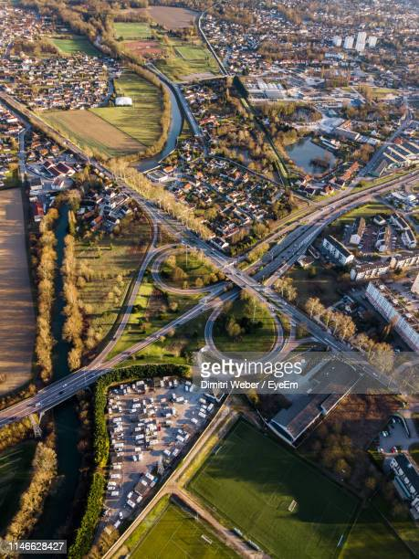 high angle view of road amidst buildings in city - troyes champagne ardenne photos et images de collection