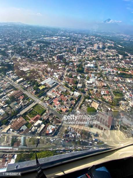 high angle view of road amidst buildings in city - guatemala city stock pictures, royalty-free photos & images