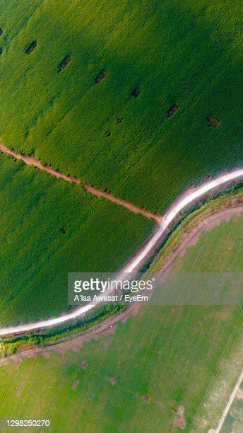 high angle view of road amidst field - netanya stock pictures, royalty-free photos & images