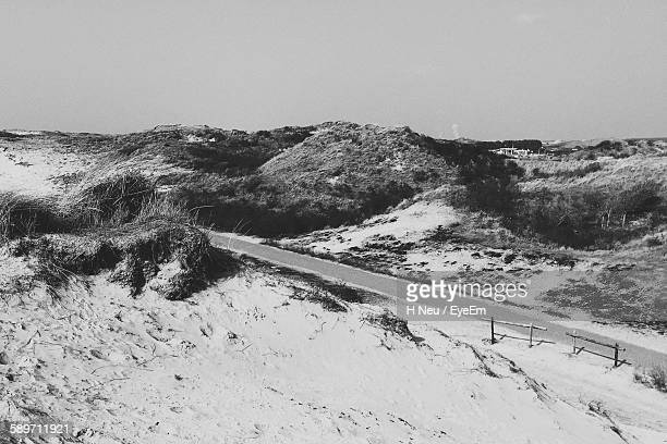 high angle view of road amidst mountain - neu stock pictures, royalty-free photos & images