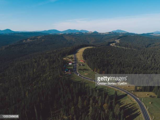 high angle view of road amidst mountains against sky - bortes ストックフォトと画像