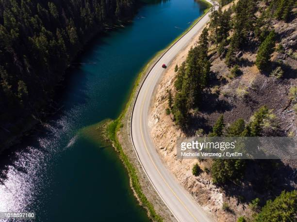 high angle view of road amidst trees - kamloops stock pictures, royalty-free photos & images