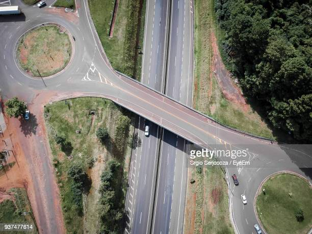 high angle view of road amidst trees - assis ストックフォトと画像