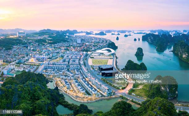 high angle view of road by buildings against sky - halong bay stock pictures, royalty-free photos & images