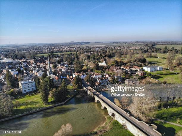 high angle view of road by buildings against sky - oxfordshire stock pictures, royalty-free photos & images