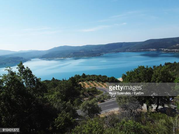 high angle view of road by trees against sky - alpes de haute provence stock pictures, royalty-free photos & images