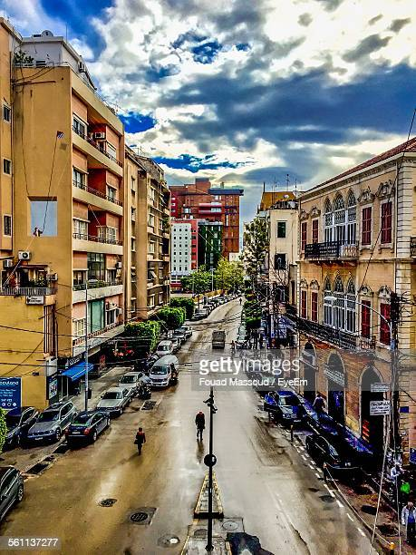 High Angle View Of Road In City Against Cloudy Sky