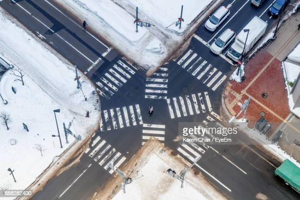 high angle view of road intersection in city - sapporo japan stock pictures, royalty-free photos & images
