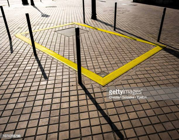 high angle view of road marking on paving stone - christian soldatke stock pictures, royalty-free photos & images