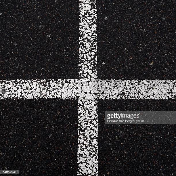 High Angle View Of Road Marking On Street