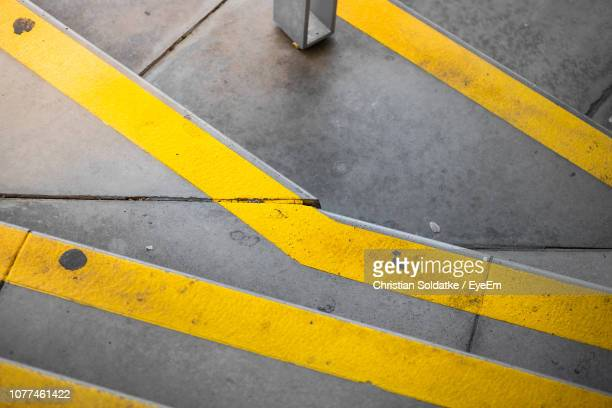 high angle view of road marking - christian soldatke stock pictures, royalty-free photos & images
