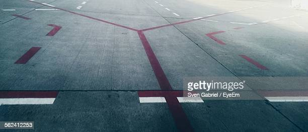 High Angle View Of Road Markings On Airport Runway