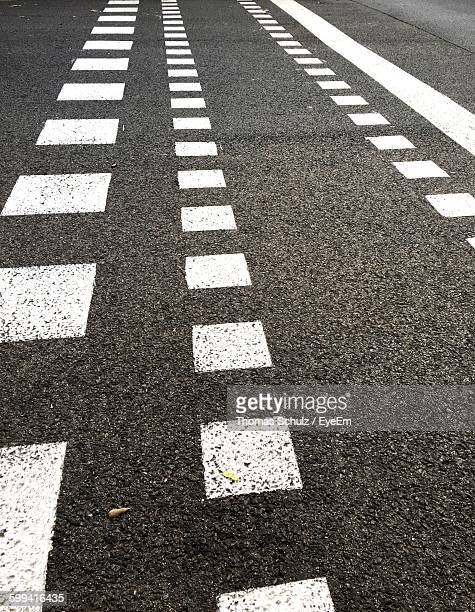 High Angle View Of Road Markings On Asphalt