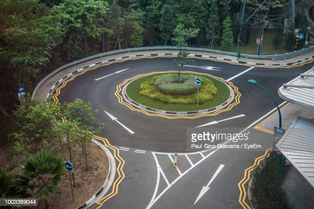 high angle view of road markings on city street - curved arrows stock photos and pictures