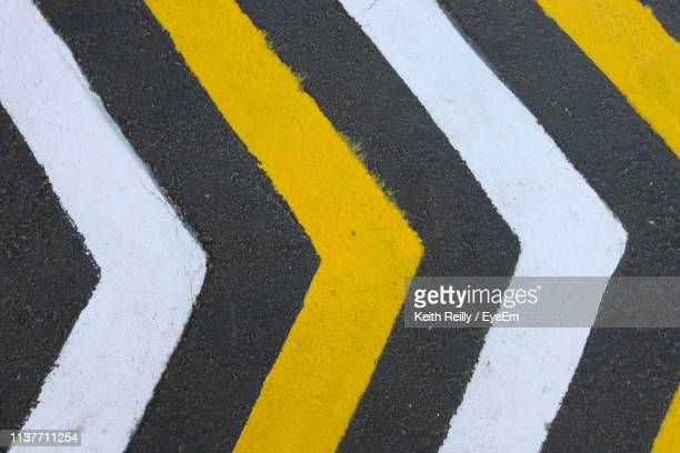 high angle view of road markings on road - road marking stock pictures, royalty-free photos & images