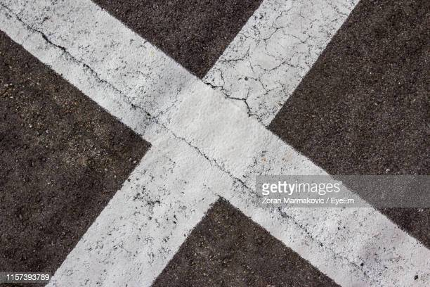 high angle view of road markings - road marking stock pictures, royalty-free photos & images