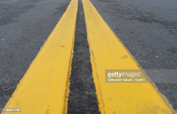 high angle view of road markings - oleksandr vakulin stock pictures, royalty-free photos & images
