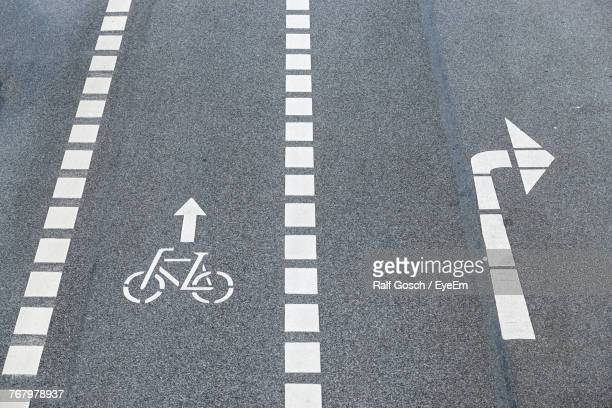 high angle view of road signs on street - bicycle lane stock pictures, royalty-free photos & images