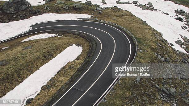 high angle view of road through icy landscape - bortes cristian stock photos and pictures