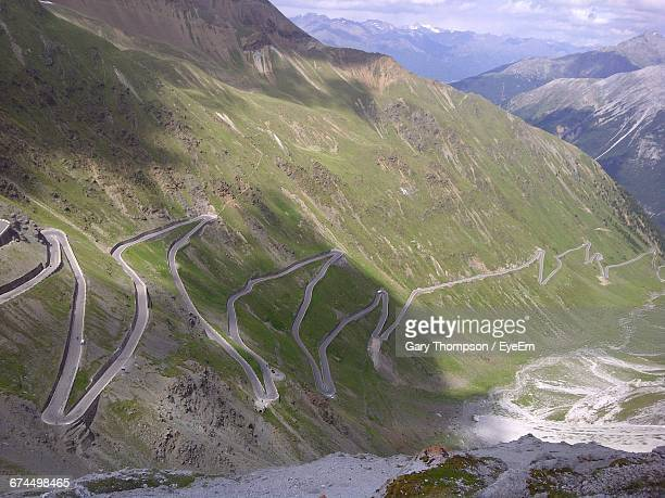 High Angle View Of Road Through Mountains Against Cloudy Sky