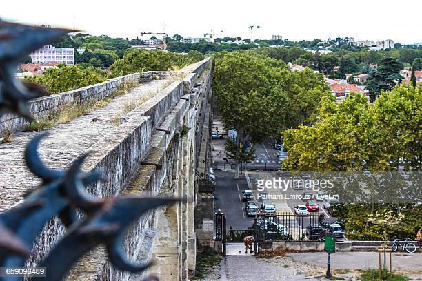 high angle view of roads by trees in city - parham emrouz stock pictures, royalty-free photos & images