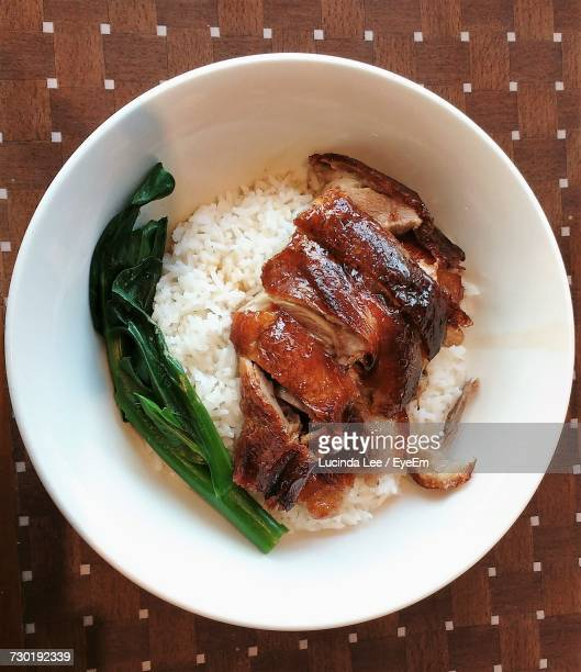 High Angle View Of Roast Duck On Plate On Table