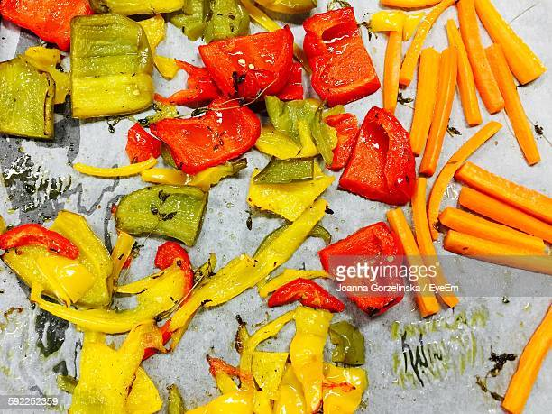 High Angle View Of Roasted Bell Peppers And Carrots In Tray
