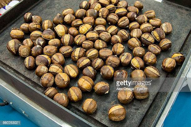 High Angle View Of Roasted Chestnut In Tray